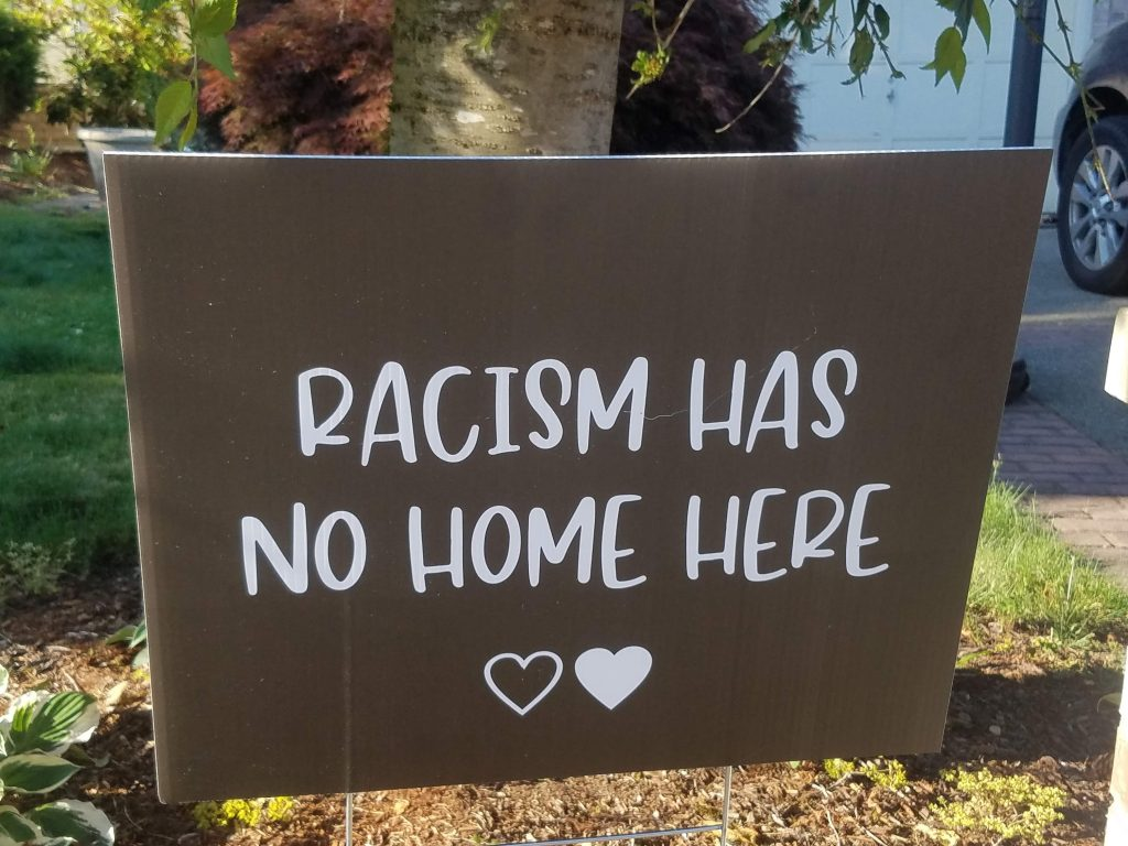 sign saying 'racism has no home here'